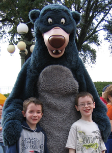2 young boys posing with Disney's character Blu from the Jungle Book