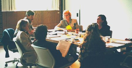 Macy Editorial Board members at work during their recent face-to-face meeting in Worcester.
