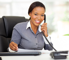 African American woman on the phone in an office