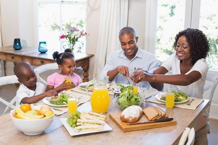 Happy Family enjoying a healthy meal at home