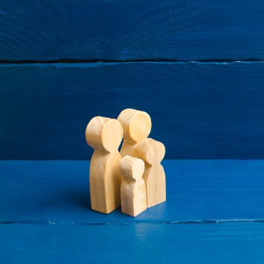 bigstock-Wooden-Figurines-Of-People-In--258955342.jpg