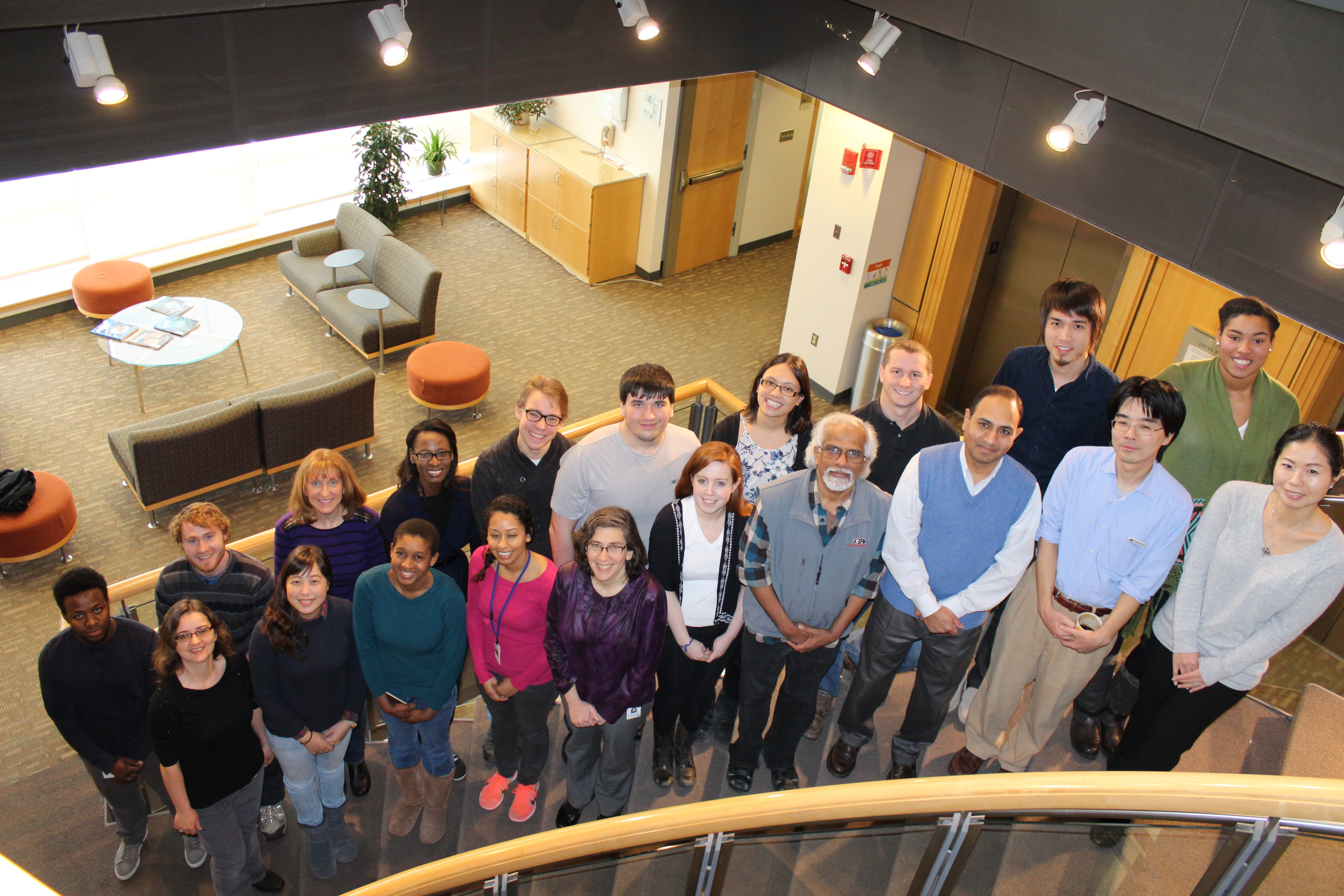 groups photo of Schiffer Lab members standing on stair case