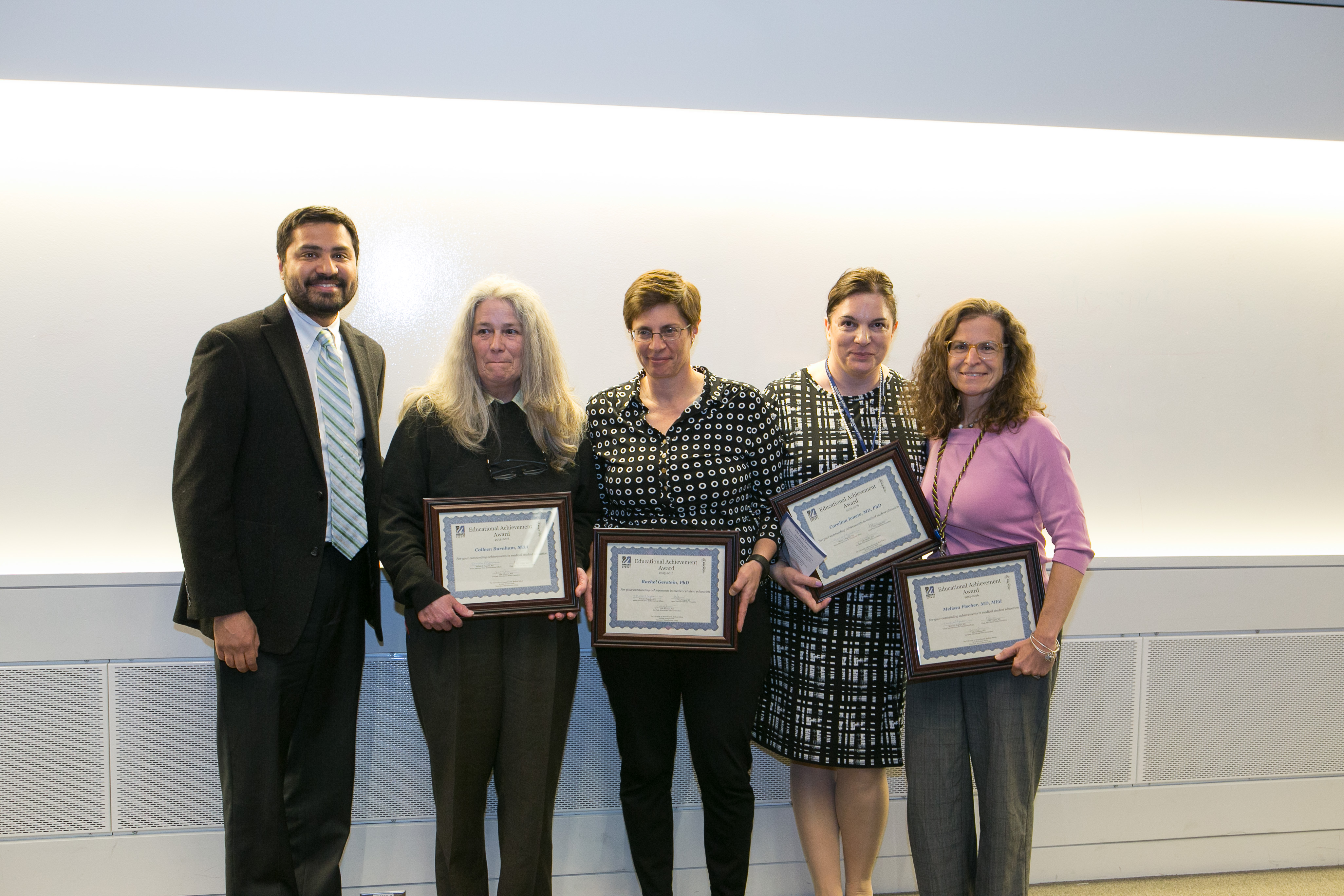 Vijay K. Vanguri, MD Chair, Educational Policy Committee presents Capstone Course Leaders Colleen Burnham MBA, Rachel M. Gerstein PhD, Steven C. Hatch MD, Carolina Ionete MD, PhD, and Melissa A. Fischer MD, MEd with the Educational Achievement (Star) Award.